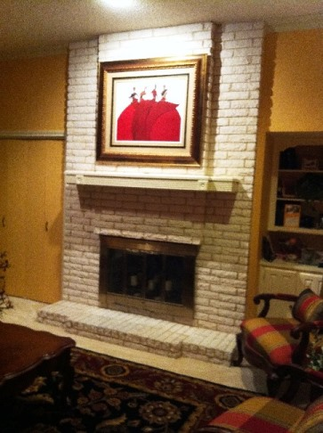 Original fireplace with inspiration artwork.