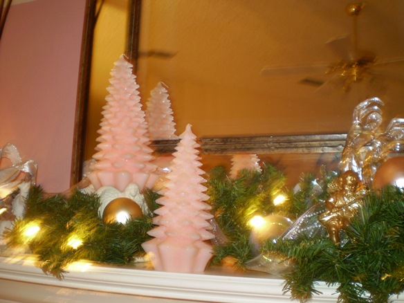 Exquisite pink Christmas tree candles adorn mantle garland.