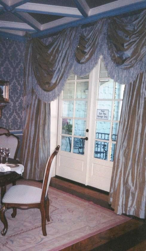 Formal dining room in Country French style with soft shades of blue.