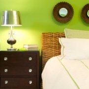 Bold walls are tempered by cool furnishings and bedding.