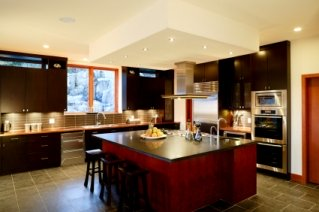 Modern Kitchen -  expansive cabinetry, stainless steel appliances, and a large island complete this spacious kitchen.
